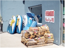 Firewood and Tow Boats outside The Cove Corner Store